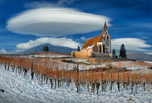 lenticular clouds and church
