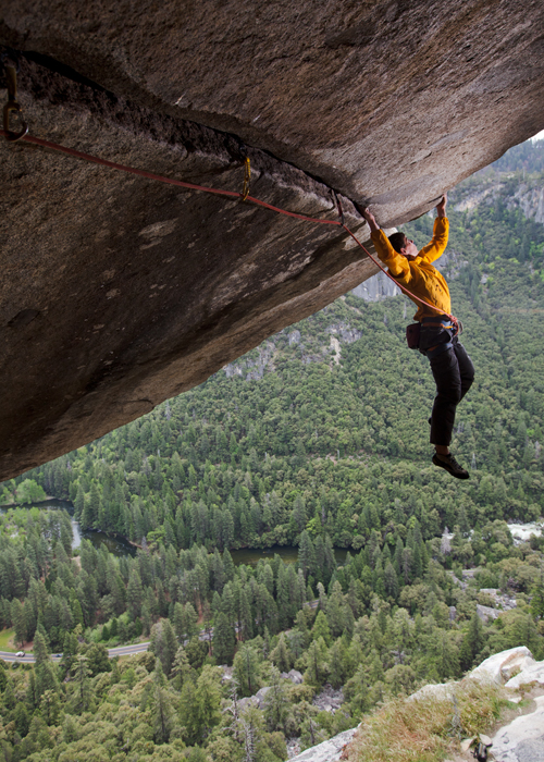 Alex Honnold climbing Seperate Reality, a difficult over hanging roof crack, Yosemite, CA